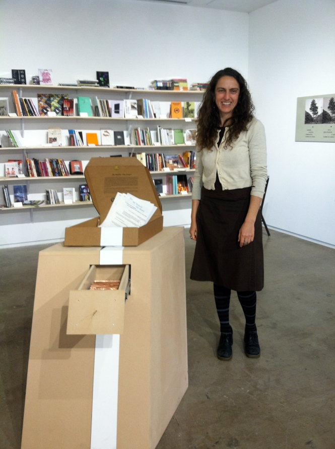 Antena cofounder Jen Hofer with the Watcher Files, a work by Garrick Imatani and Kaia Sand.